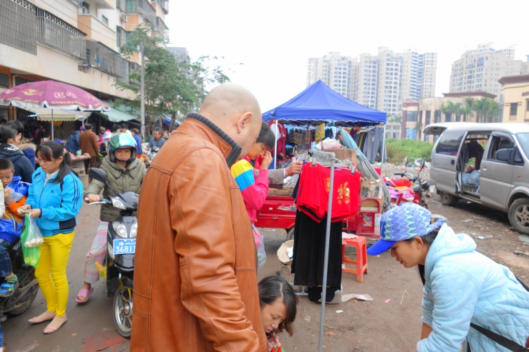 """A red underwear with the Chinese word """"福"""" printed on it. A scene in a wet market near 滨江绿都 (Bin Jiang Lu Du) in Haikou, Hainan Island."""