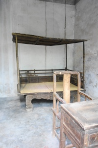 The ancient bed, chair and study table.
